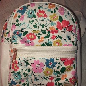 White and flowered backpack